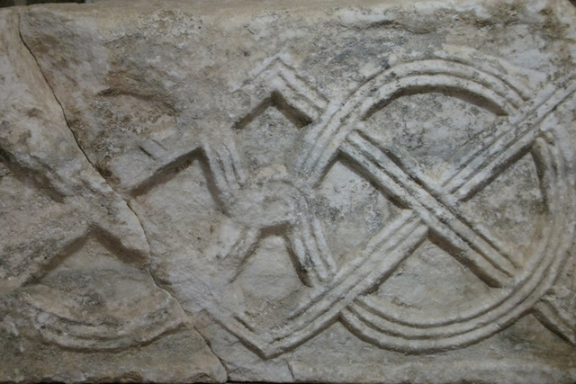 Detail of stone fragment with three-ribbon interlace, 9th c. (Museum of Dominican monastery)
